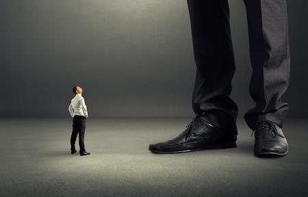 Photo pour small businessman looking at his big boss - image libre de droit