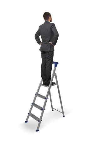 back view of businessman standing on the stepladder and looking forward. isolated on white background