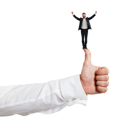 Photo for happy small businessman standing on big thumbs up and raising his hands up. isolated on white background - Royalty Free Image