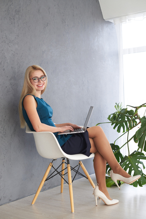 Photo for Young businesswoman working on laptop - Royalty Free Image