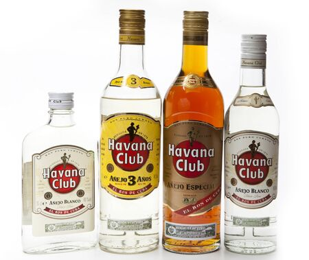 """Photo pour SAINT-PETERSBURG, RUSSIA- FEBRUARY 16, 2013: different sizes and shapes bottles with white and dark rum """"Havana Club"""", produced in Cuba - image libre de droit"""