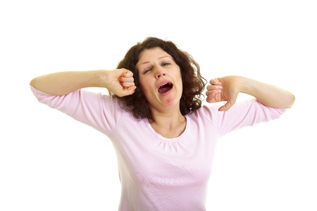 Young woman with brown hair  yawns and stretches, isolated on white background
