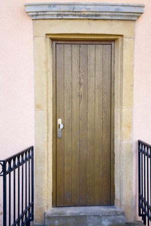 Vew of a modern  wooden door in old facade, city Luxembourg Luxembourg, summer