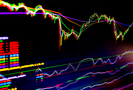 Foto de Selective focus of Business graph charts of financial instruments with various type of indicators combine with gold and account book and money. Concept investment. Moving average graph - Imagen libre de derechos