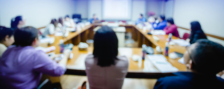 Photo pour business conference in the meeting room, auditorium for shareholders' meeting or seminar event, many business people listening on the conference, blurry image. - image libre de droit