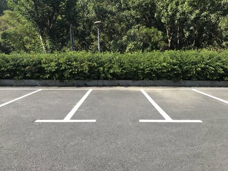 Photo for Empty outdoor parking space. Car parking lot with white lines mark. - Royalty Free Image