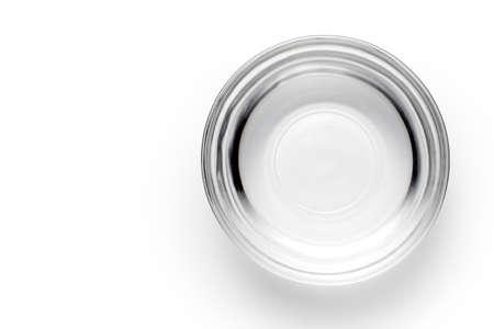 Foto de A bowl of water on white background, Top view. - Imagen libre de derechos