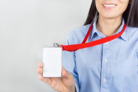 Photo pour Woman holding Identification white blank plastic id card. - image libre de droit