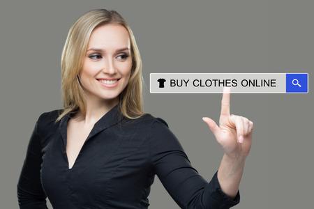 Photo pour woman pressing clothes, buy online button. touch screen - image libre de droit