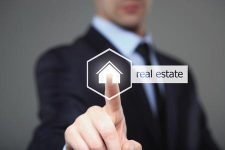 Photo pour business, technology, internet and networking concept - businessman pressing real estate button on virtual screens - image libre de droit
