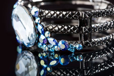 Bracelet with blue stones over black. close-up