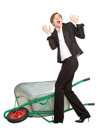allegory. office worker, manager, tortured business woman with a wheelbarrow isolated on white background