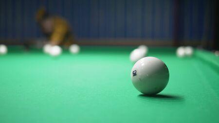 man plays billiards. the concept of billiards, hobbies, sports.