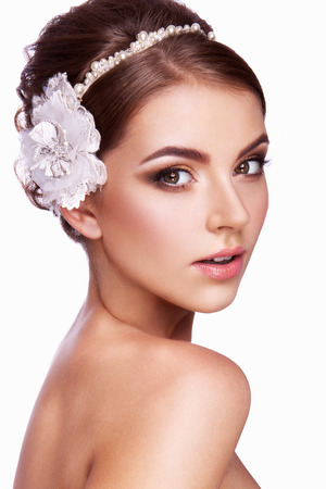 Photo pour Portrait of a beautiful woman with flowers in her hair. Bride. - image libre de droit
