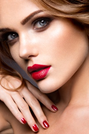 Photo for Close-up portrait of beautiful woman with bright make-up and red lips - Royalty Free Image