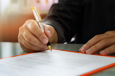 Photo for Close up of business man signing contract making a deal, business contract details. Businessman signing an official document - Royalty Free Image