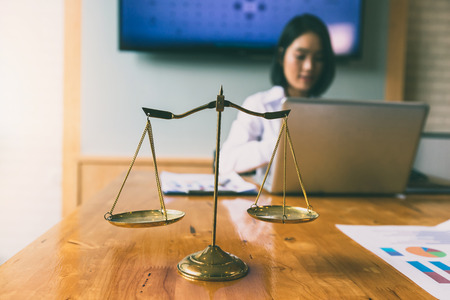 Photo pour Gold brass balance scale over with lawyer background. - image libre de droit