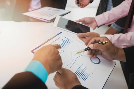 Photo pour Businessmen discussing together in meeting room. Business team meeting and discussing project plan. Professional investor working with business project together. Finance managers task. - image libre de droit