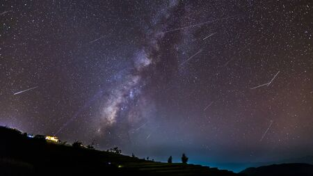 Photo for Long time exposure night landscape with the milky way during meteor shower over a mountain with hut. - Royalty Free Image