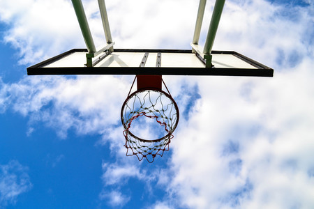 Basketball board with blue sky