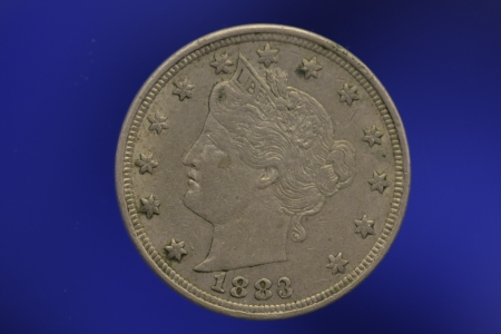 V Nickel Liberty Head 1883 on Blue Background