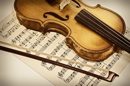 Old violin and musical notes