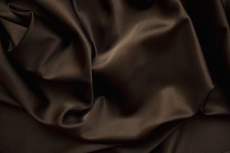texture of cloth Chocolate brown satin  silk close up