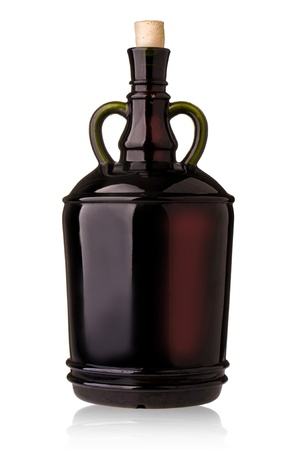 big dark glass wine bottle on a white background