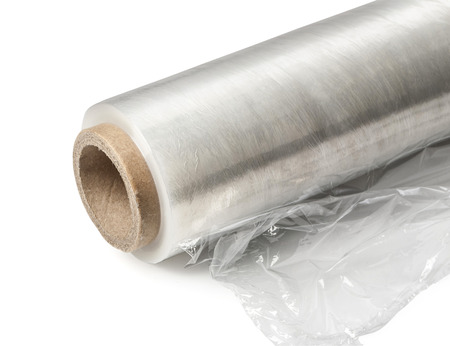 Roll of wrapping plastic stretch film. Close-up. Isolated on white background.With clipping path
