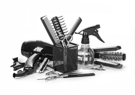 Hairdressing tools on white background