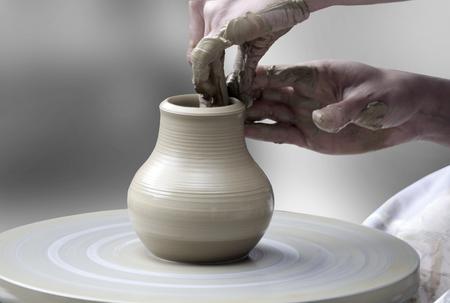 Photo pour Woman's hands making ceramic cup on potter's wheel - image libre de droit