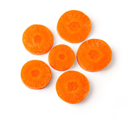 Foto de fresh organic chopped, slices orange carrots isolated on white background, top view - Imagen libre de derechos