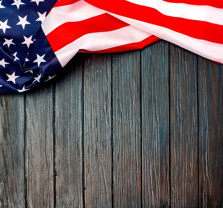 Photo pour Crumpled US flag. US flag on wooden background. National banner on white floor. Unity and pride. - image libre de droit