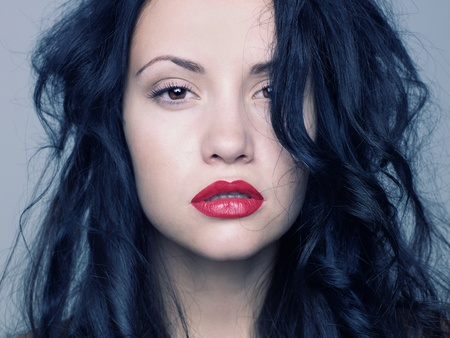 Photo of young beautiful woman with red lipstickの写真素材