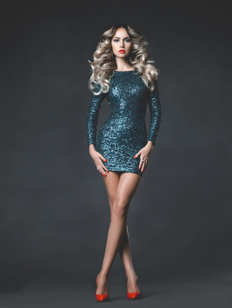 Fashion photo of young gorgeous woman in sequined dress