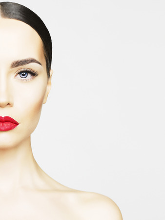 Photo pour Studio portrait of beautiful young woman with perfect skin. Beauty and care. Spa salon. Red lipstick - image libre de droit