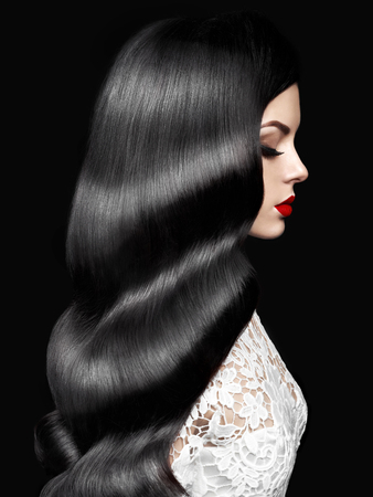 Photo pour Fashion studio photo of beautiful model girl brunette with long curled hair and red lips. Hairstyle Hollywood wave. Wedding image hairstyle. Perfect makeup - image libre de droit