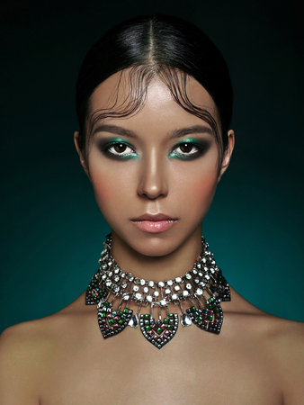 Foto de Fashion studio portrait of beautiful asian woman with diamond necklace. Fashion and Beauty. Perfect makeup - Imagen libre de derechos