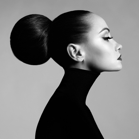 Foto de Black and white fashion art studio portrait of beautiful elegant woman in black turtleneck.  Hair is collected in high beam.  Elegant ballet style - Imagen libre de derechos