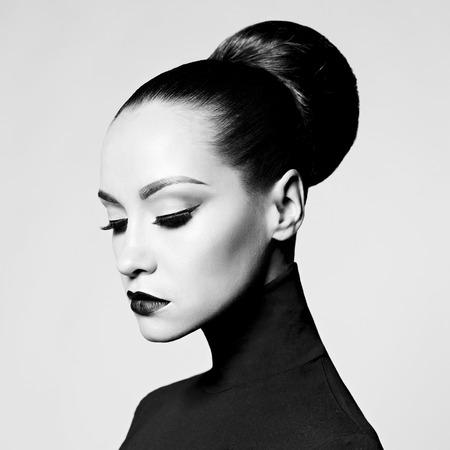 Foto de Black and white fashion art studio portrait of beautiful elegant woman in black turtleneck.  Hair is collected in high beam.  Elegant ballet style - Imagen libre de derechos