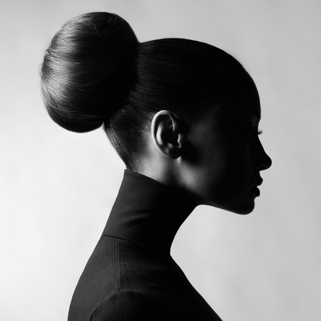Photo pour Black and white fashion art studio portrait of beautiful elegant woman in black turtleneck.  Hair is collected in high beam.  Elegant ballet style - image libre de droit