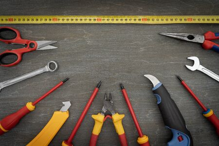 Various tools for repair, a tool kit for the home, on a vintage wooden background, safe work for construction.