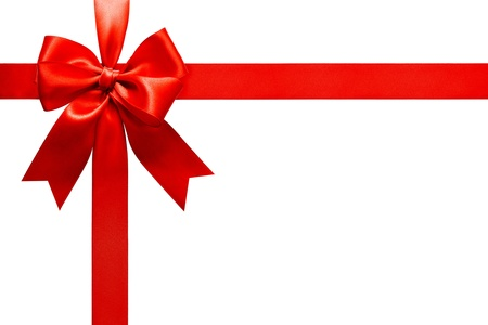 Foto de Big red holiday bow on white background  - Imagen libre de derechos