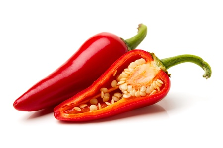 Two red hot peppers over white