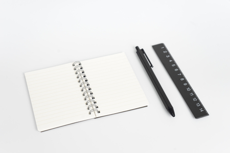 Stationery set such as Note books Ruler and Pens on white background.