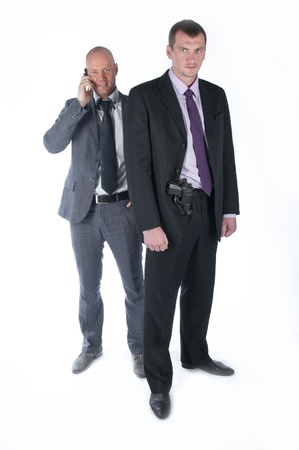 The businessman and the bodyguard with a pistol