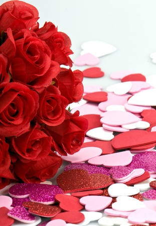 Bouquet of artifical red roses with valentines.