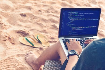 Photo pour A programmer typing source codes at the beach in a relaxing working environment. Studying, Working, Technology, Freelance Work Concept. - image libre de droit