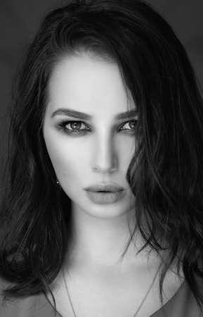 Photo pour portrait of a woman with dark hair and makeup on her face - image libre de droit