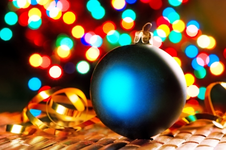 Photo pour Blue Christmas ball on the background of blurred lights garlands. - image libre de droit